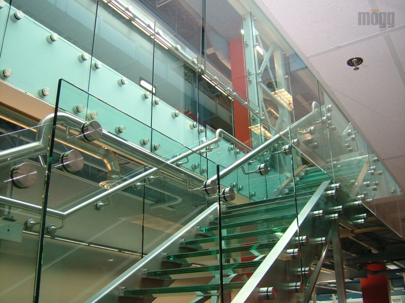 Glass railing with standoffs on Stainless steel stringer, glass threads and glass walls