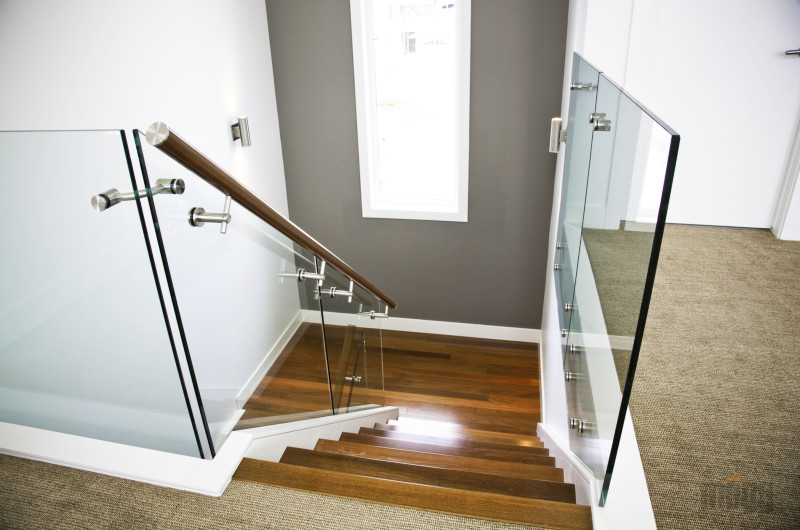 glass railing with wooden handrail and glass connectors